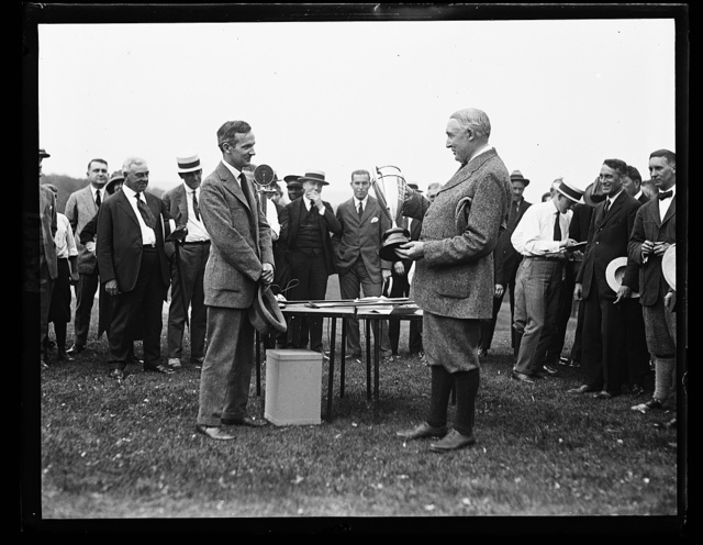 [Group with Warren G. Harding holding trophy]