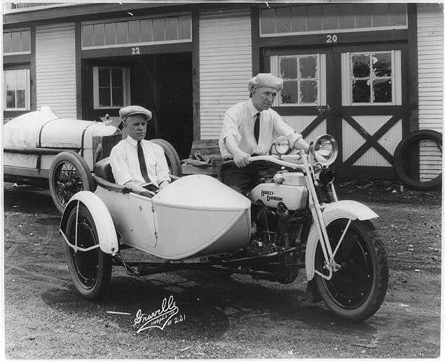 [Jimmy Murphy, winner of 500-mile auto race at Indianapolis, Ind., May 30, 1922, and Ernie Olson, mechanic, seated on Harley-Davidson motorcycle and in sidecar]