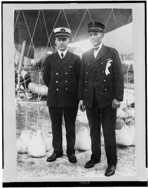 [Lieut. W. Reed, Pensacola, Florida, and Chief Rigger Kit Mallenax of Pensacola, flyers of one of the Navy balloons in the Milwaukee race, standing under balloon]