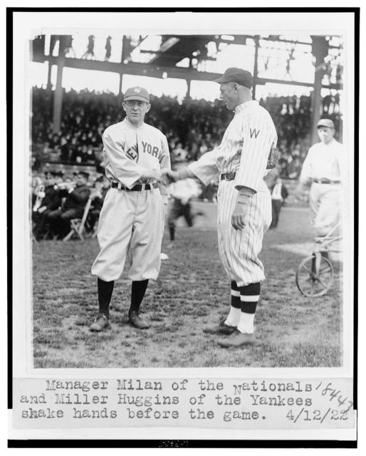 Manager Milan of the Nationals and Miller Huggins of the Yankees shake hands before the game