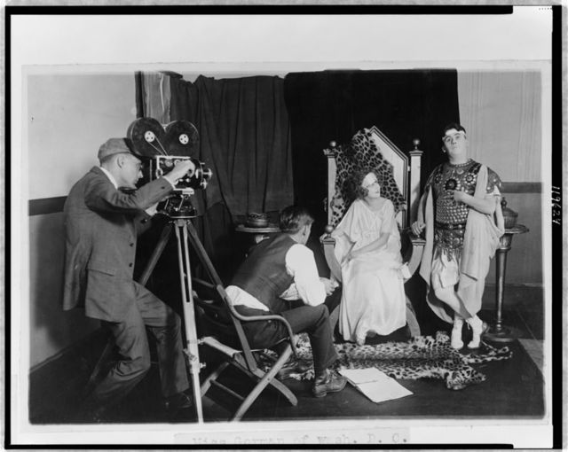 [Margaret Gorman (Miss America 1921), and Stephen(?) Fegan being filmed for a burlesque on the burning of Rome by the Washington Producing Co.]