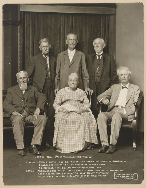 "Mark Twain's boyhood friends Standing - Noval [i.e. Norval] L. Brady, age 82. Son of James Brady, first mayor of Hannibal, Mo. Dr. B.Q. Stevens, age 85. Boyhood friend of Mark Twain. J.L. Robards, age 84. Boyhood friend of Mark Twain. Sitting - Moses D. Bates, age 84. Son of Moses D. Bates, founder of Hannibal, Mo. Mrs. Elizabeth Frazer, age 84. ""The real Becky Thatcher."" T.G. Dulaney, age 81. A counter part of Mark Twain / / Copyright photo by Jean & Hal Frazer, Hannibal, Mo."