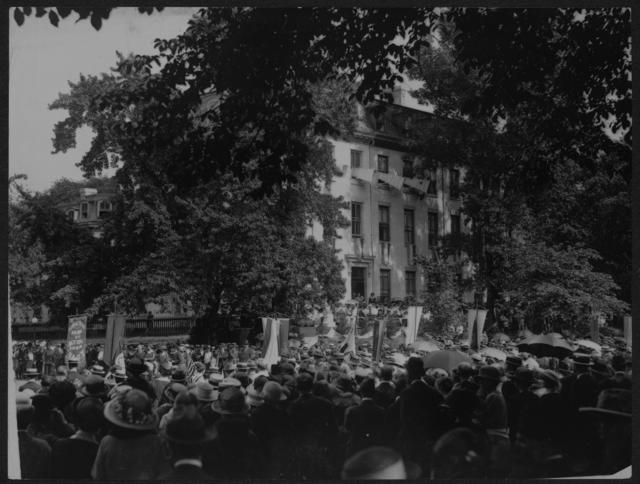 [National Woman's Party members and crowd gathered in front of the Alva E. Belmont House during its dedication ceremony.]