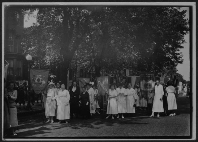 [National Woman's Party members gathered outside with banners during the dedication ceremonies for the Alva E. Belmont House, 1922.]