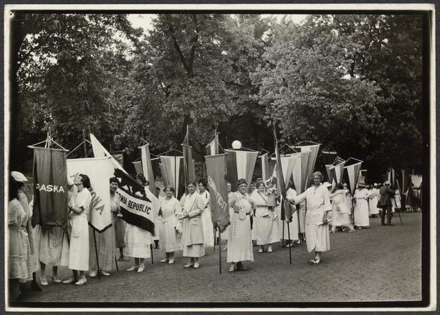 [National Woman's Party members standing in line with banners during the dedication ceremonies for the Alva E. Belmont House, 1922.]