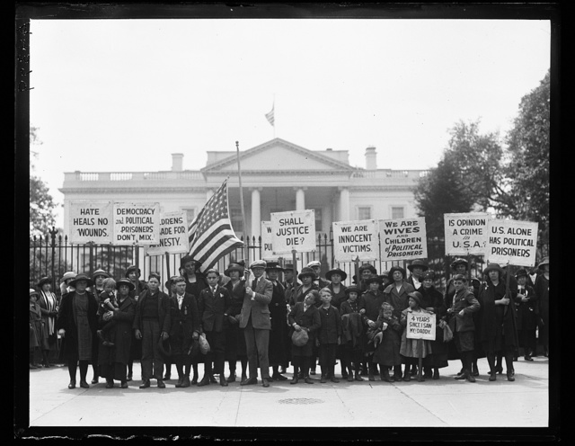 """[Picketers at White House with signs: """"Democracy and Political Prisoners Don't Mix,"""" """"Shall Justice Die?"""" """"We are Innocent Victims,"""" etc. Washington, D.C.]"""