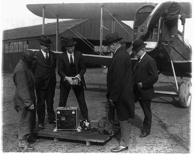 Postmaster General Work and his assistants inspecting the Radio equipment recently installed on aero mail planes
