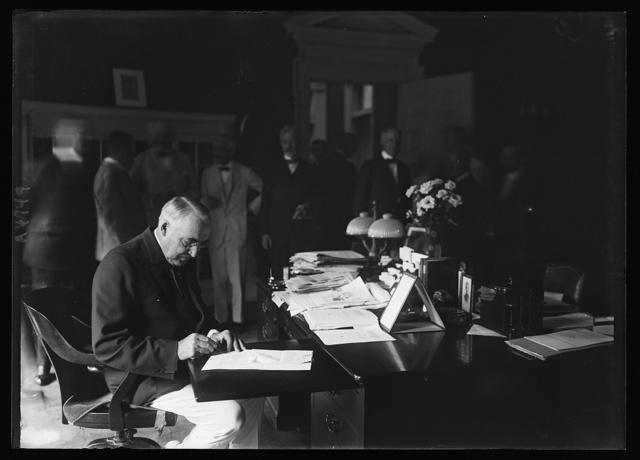 Pres. Harding signing Mileage Script Bill
