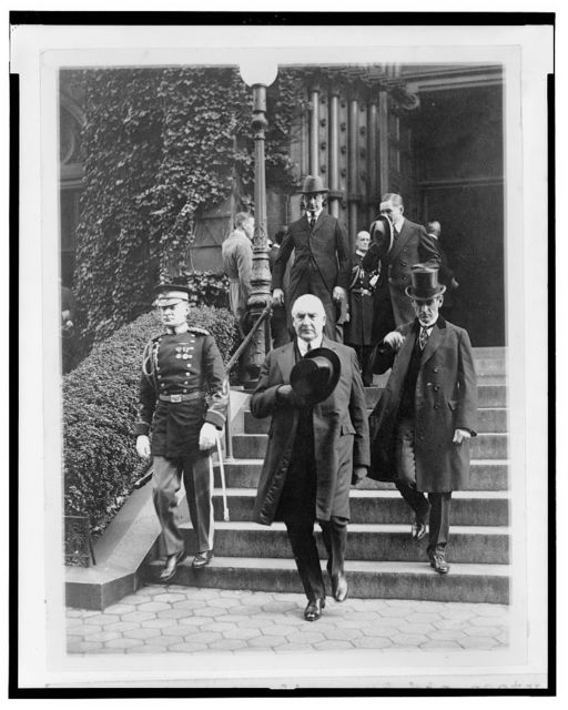 President Harding and his secty. George Christian leaving St. Patricks Church after attending the funeral of Senor Don J. Antonio Lopez Gutierrez, Minister of Honduras, today