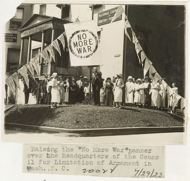 "Raising the ""No more war"" banner over the headquarters of the Council for Limitation of Armaments in Wash., D.C."