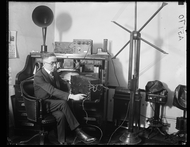 Rep. Vincent M. Brennan, of Mich., listening in at his office to the debates of floor of House. Mr. Brennan has introduced resolution providing for broadcasting to the country of the proceedings and debates of Congress through the Navy Air Station at Arlington