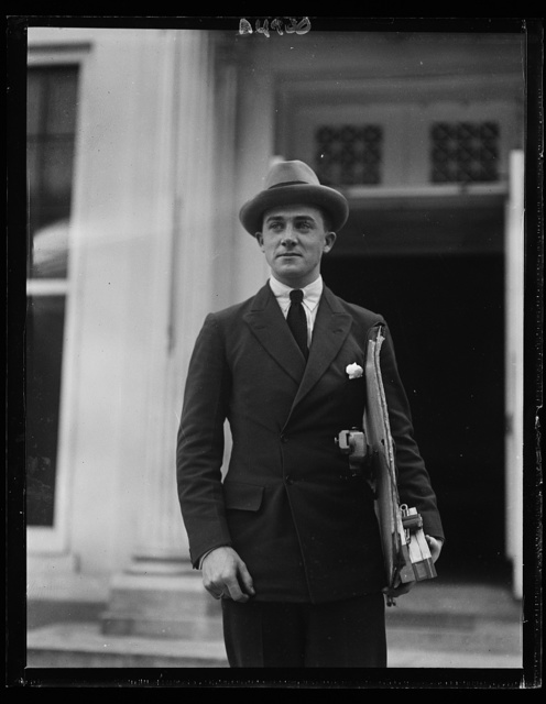 Simon Elwes, son of Lady Winnigrid Elwes, of London, leaving the White House after completing a series of pencil sketches of Pres. Harding