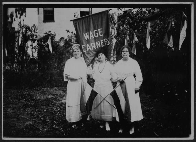 "[Three National Woman's Party members with ""Wage Earners"" banner during the dedication ceremonies for the Alva E. Belmont House, 1922.]"