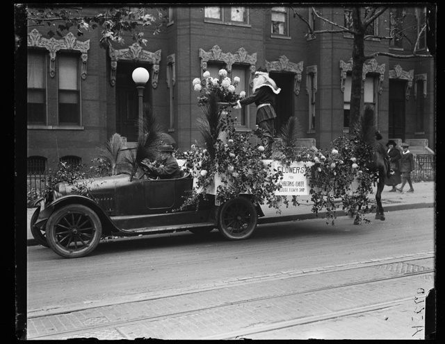 [Trucks with flowers: Louise Flower Shops]