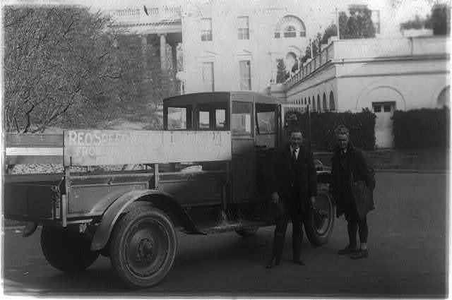 [Two men standing next to a Reo truck, which brought Eskimo pie from Chicago to President Harding at the White House]