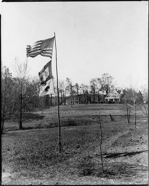 [U.S., Red Cross & unid. flag on flagpole; Clara Barton House in backgrd., Glen Echo, Md.]