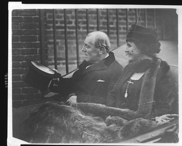 [Woodrow Wilson and Edith Wilson participating in Armistice Day festivities]