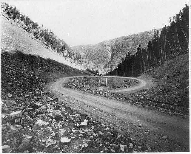 """Yellowstone National Park: Spiral Bridge, """"S"""" Hill, and car, Cody Road"""