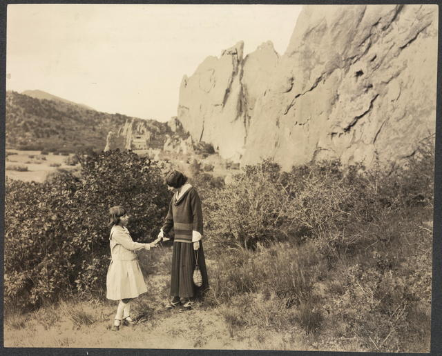 Alice Paul, leader of the feminist movement in America and vice president of the Woman's Party with Mildred Bryan, youngest Colorado feminist in the Garden of the Gods at Colorado Springs where the Party will present its Equal Rights Pageant on September 23rd, launching its western campaign for an amendment to the federal Constitution giving Equal Rights to women.