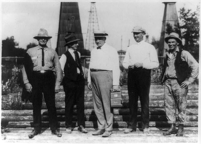 American oil men in the fields of Roumania. Mr. Carpenter makes an inspection of the Standard Oil fields and talks to Mr. Hughes, the Director