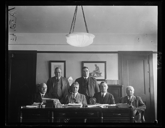 Commission sent by Secy. of Labor Davis to the Hawaiian Islands to investigate labor problems and to report on advisability of allowing Chinese Labor to enter the Islands as requested by Hawaiian govt. First row, left to right: L.E. Sheppard, Secy. Davis, O.R. Hartwig, and Hywel Davies. Standing: John Doulin and Fred Keightly