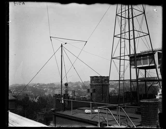 [Communication tower/wires on roof top]