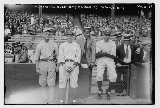 [Danny Murphy, coach, Philadelphia AL, Joe Bush, New York AL, Chief Bender in a suit, Bob Shawkey, New York AL (baseball)]