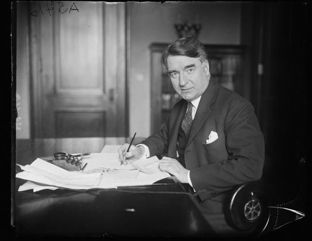 Dr. Royal S. Copeland, Health Commissioner of N.Y., and Senator-elect, at desk in Senate office bldg.