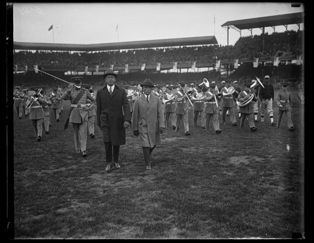 [Dwight Davis on field with marching band at ball park]