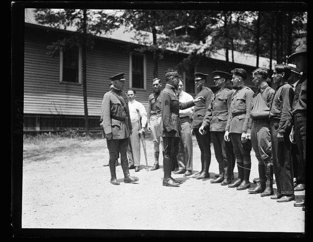 Gen. Henri Gourand, who commanded American troops during the Great War, visiting the soldiers at Walter Reed