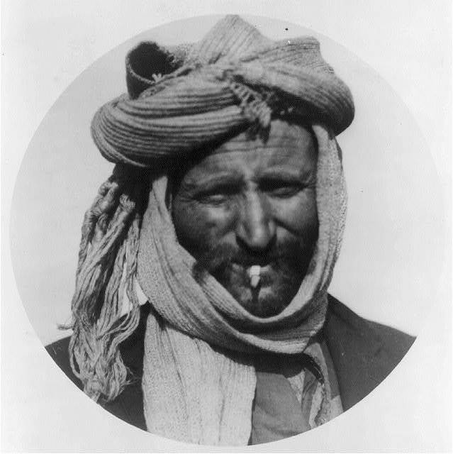 [Greek man from the Caucasus in camp at Salonica with scarf worn as hat; head]