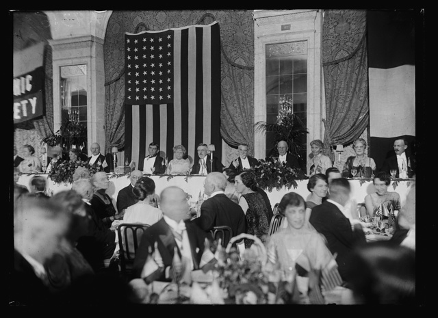[Group at dinner; includes John W. Weeks, near left, and Henry Cabot Lodge, Sr., center right]