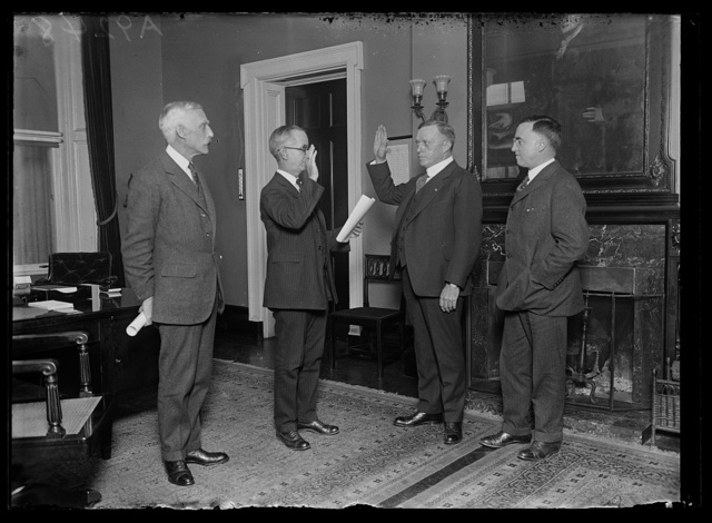 [Group at swearing in; Andrew W. Mellon, left]