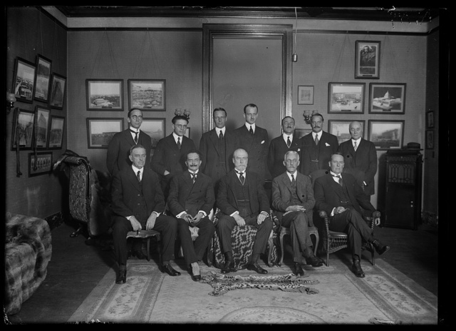 [Group; Charles Evans Hughes and Andrew W. Mellon, front center]