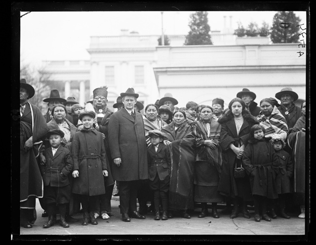 Group of Osage Indians at White House with Commissioner Burke who asked the Pres. for an increase in their allowance