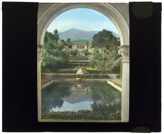 """[""""Las Tejas,"""" Oakleigh Thorne house, 170 Picacho Road, Montecito, California. View from swimming pool pavilion to house]"""