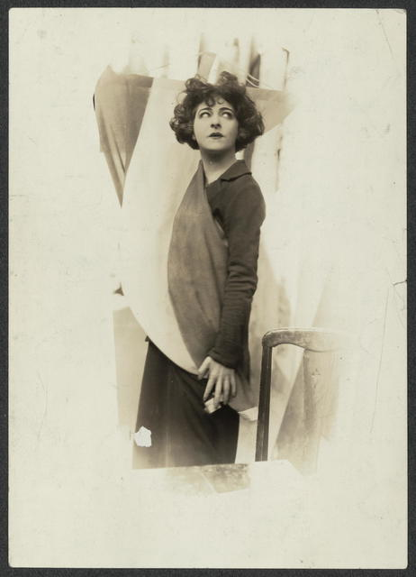 Madame Alla Nazimova, the great Emotional actress, picks up the Purple White & Gold  Banner of the National Woman's Party in token of her Allegiance to Equality for men and women. Mme. Nazimova has just become a Founder of the Woman's Party.