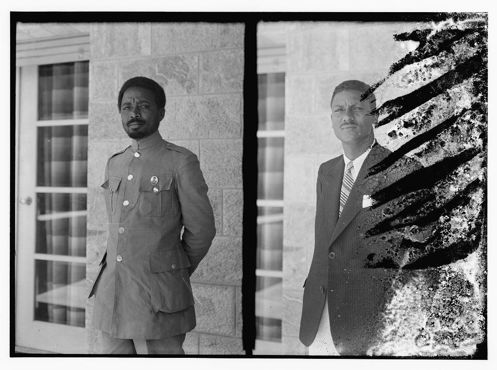 [Man in military uniform and man in suit jacket, members of Haile Selassie's entourage?]