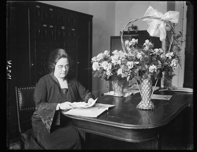 Mrs. M.E. Noland, at desk
