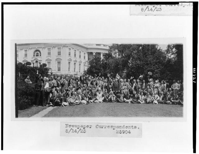 [President Coolidge posed with newspaper correspondents on lawn of the White House]