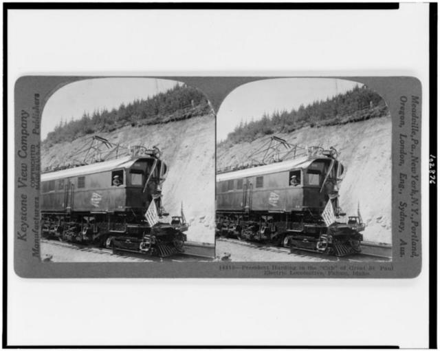 """President Harding in the """"cab"""" of Great St. Paul electric locomotive, Falcon, Idaho"""