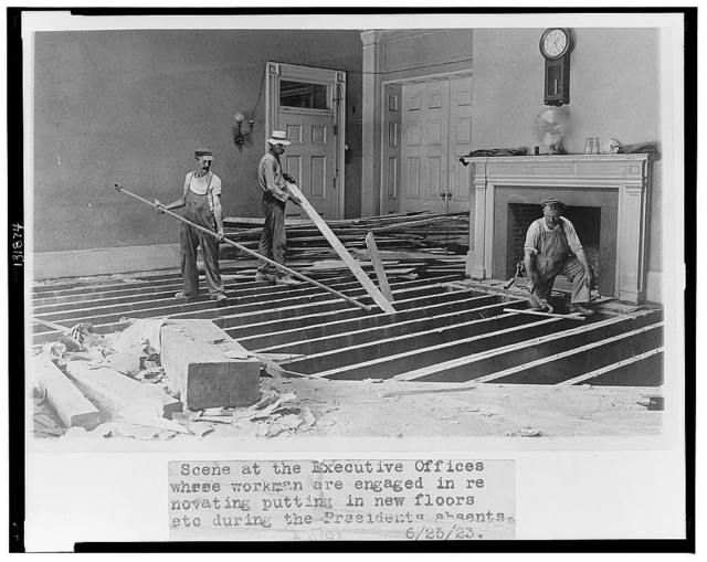 Scene at the executive offices where workmen are engaged in renovating, putting in new floors, etc. during the President's absents [sic]