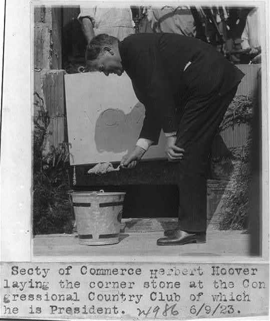 Secretary of Commerce Herbert Hoover laying the corner stone at the Congressional Country Club, of which he is President