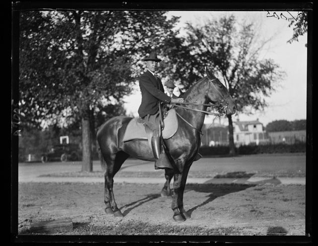 Secy. E. Bascom Slemp on horse