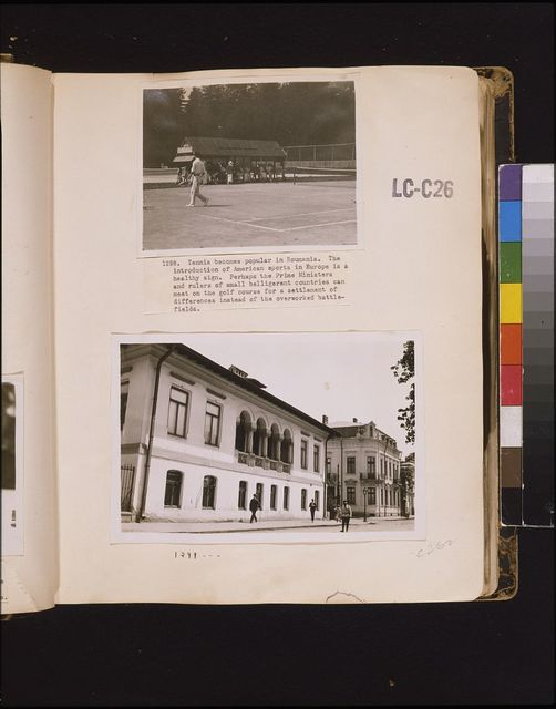 Tennis becomes popular  in Roumania. The introduction of American sports in Europe is a healthy sign. Perhaps the prime ministers and rulers of small belligerent countries can meet on the golf course for a settlement of differences instead of the overworked battlefields [Building on the street, Romania]