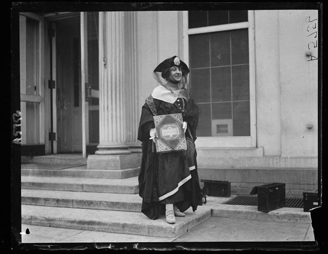 "[Woman with book ""Roumania"" at White House, Washington, D.C.]"