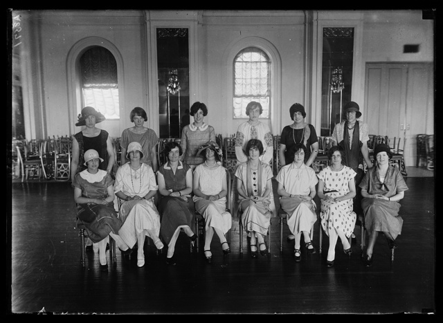 "[30 Wash. debutantes are rehearsing for a miniature revue to be given at Keith's Theatre, Wash., for the benefit of ""Roxie's"" radio fund for the soldiers. The revue will be known as ""Keith's Summer Follies."" Here are a few of the society girls rehearsing seated: left to rt.: Doris Wagner, Cecil Jones, Virginia Edwards and Jessie Adkins; standing, left to rt.: Mary Stitt, Corienne Stevens, Eliz. Hume, Norvell Munford, Kitty Wren, and Eugenia Lejuene]"