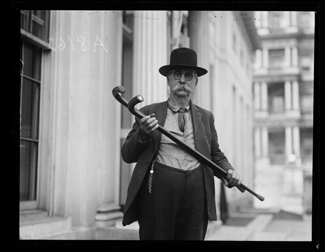 A.J. Shell of Wise County, Va. with 2 canes which he presented to Pres. Coolidge and Secy. Slemp [White House, Washington, D.C.]