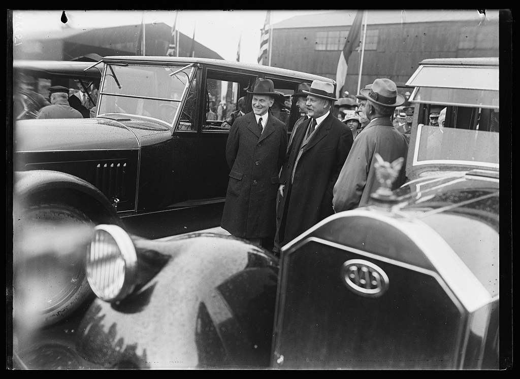 [Calvin Coolidge and John W. Weeks and group next to automobiles]