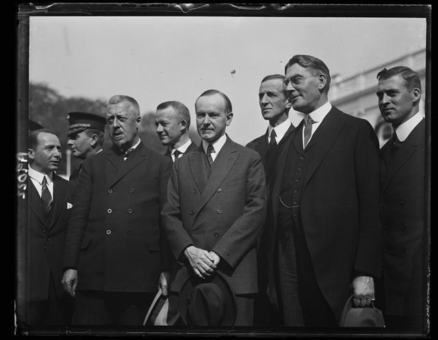 [Calvin Coolidge, Curtis D. Wilbur and group outside White House, Washington, D.C.]